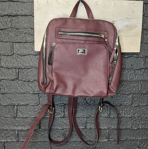 Roots plum coloured small backpack purse